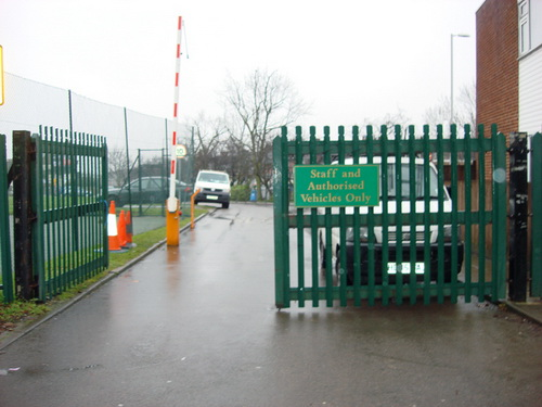 Green painted palisade double gates