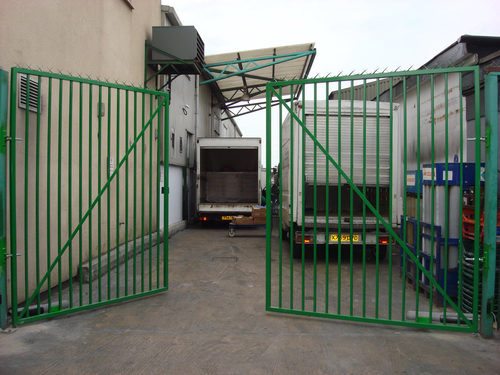 2. We installed the electronic arms to enable these gates to be opened electronically